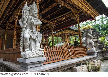 The Hindu Shrine And Demon Guardian Statue Inside Tirta Empul Temple (other Name Is Holy Spring Wate