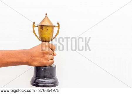 Happiness & Achievement Concept - Man Holding Winner Trophy On His Hand Isolated On White Background