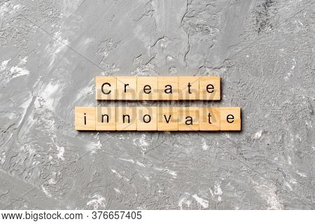Create Innovate Word Written On Wood Block. Create Innovate Text On Cement Table For Your Desing, To