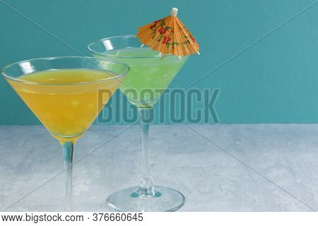 Glasses Of Assorted Fruit Non-alcoholic Cocktails On A Bright Background With An Umbrella. Health Dr