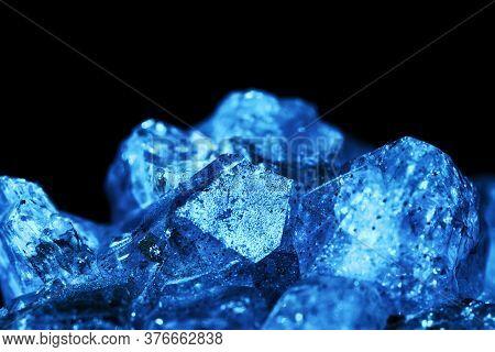 Blue Crystal. Blue Natural Mineral Stone On Black Background