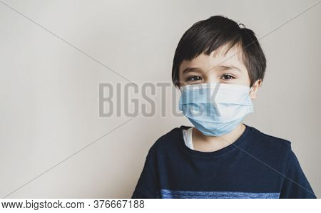 Portrait Kid Face Wearing Medical Face Mask, Mixed Race Child Boy With Beautiful Brown Eyeswearing B