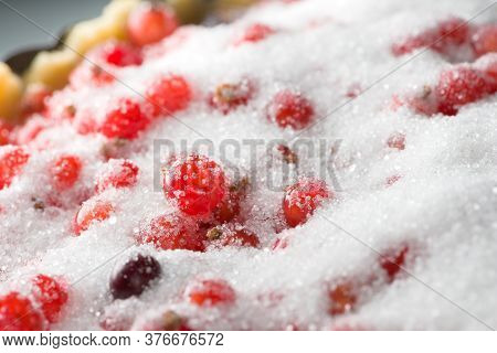 Redcurrant Stands Out From The Sparkling Granulated White Sugar Within This Prepared But Uncooked Cu