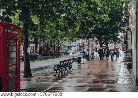 London, Uk - July 02, 2020: View Of Hampstead High Street In The Rain, People Walk On Background. Ha