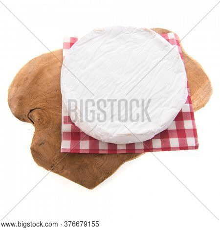 French Camembert cheese isolated over white background