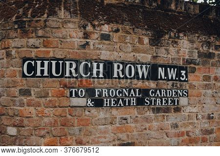 London, Uk - July 02, 2020: Street Name Sign On Brick Wall In Church Row, Hampstead, London. Hampste