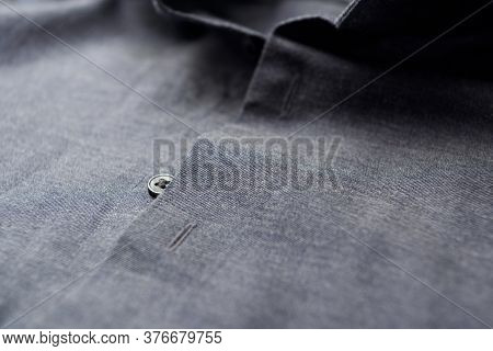 Close Up Of Dark Men's Shirt. Copy Space.