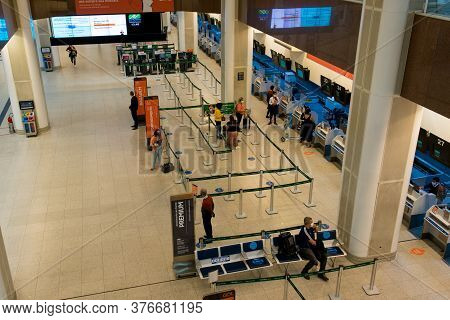 Rio De Janeiro, Brazil - July 16, 2020: Very Few Travelers At The Check In Counter At Santos Dumont