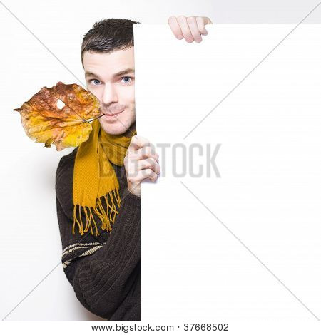 Man With Autumn Leaf Advertising Blank White Sign
