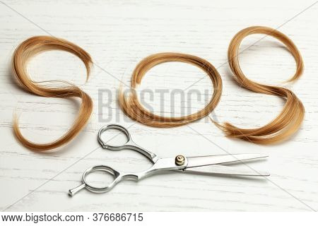 Sos From A Lock Of Hair. Problem With Hair And Haircut With Scissors. White Wood Background
