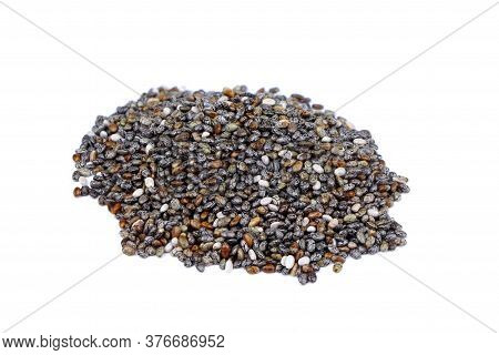Chia Seeds Isolated On A White Background. Close Up Pile Of Chia Seeds.