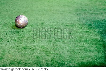 Silver Football On Artificial Turf One Alone Isolated