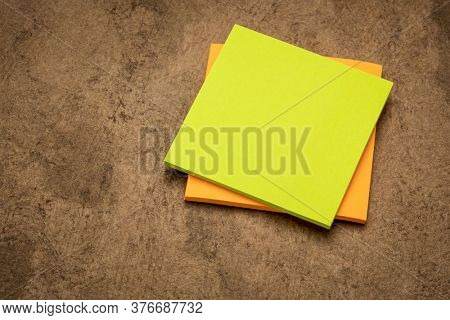 blank sticky note pads against handmade bark paper ready for a reminder text