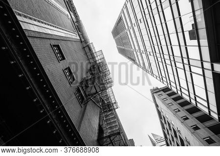 Contrasting Styles Of Old Historic And Modern Architecture From Street Level Buildings Towering Over