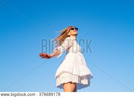 Dancing Barefoot. Surprised Careless Girl Jumping Up, Isolated On Sky Blue Background. Freedom Styli