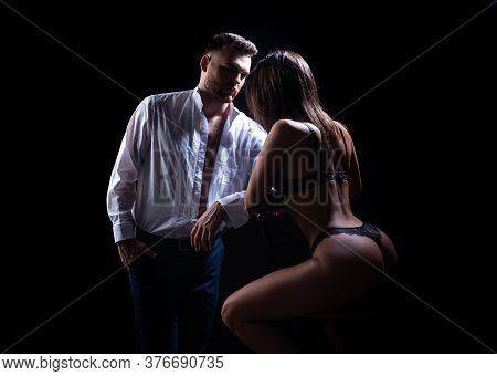 Passion Couple On A Black Background. Pretty Young Couple Of Undressed Sensual Woman With Beautiful