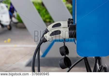 Electric Car Charging Station. Hybrid Car Electric Charger Station In The Car Park. Electric Car Cha