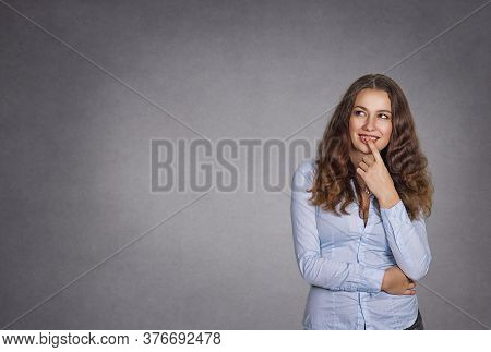 Daydreaming. Thoughtful Young Woman Looking Up Isolated On Studio Gray Background. Model Girl With L