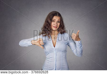 Thumb Up Or Thumb Down. Skeptical Thinking Woman Judging Deciding How To Rate A Situation Isolated O