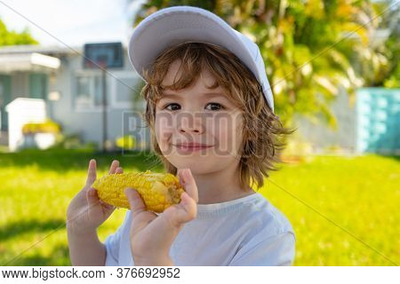 Food For Kids. Kids Eating Corn. Children With Vegetables. Kids Eating Organic Healthy Food
