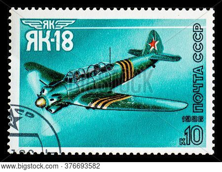 Russia, Ussr - Circa 1986: A Postage Stamp From Ussr Showing Aircraft Yakovlev Yak-18 Or Nanchang Cj
