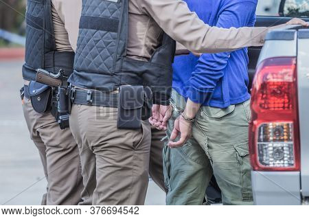 Police Helped To Catch The Guilty And Lock The Handcuffs,arrested.