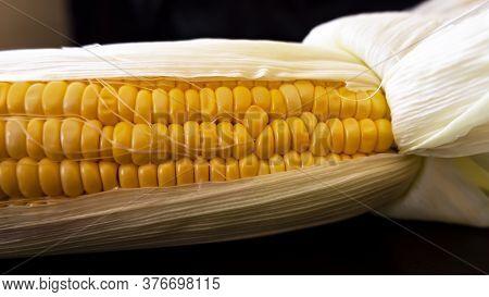 A Shot Of Fresh Raw Maize Corn & Leaves On Horizontal Foodstuff