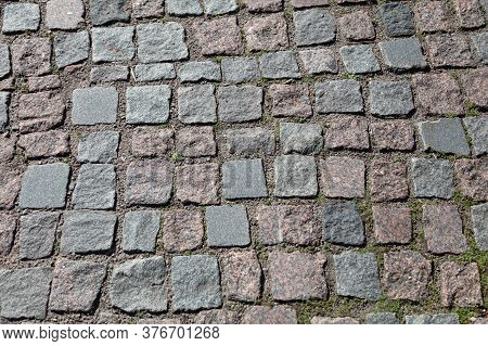 Texture, Background. The Sidewalk Is Made Of Granite Stone. Old Cobblestone Road Surface Texture, No