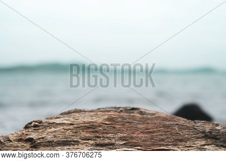 Selective Focus Od Black Stone Texture For Put Product To Show With Beach Background.