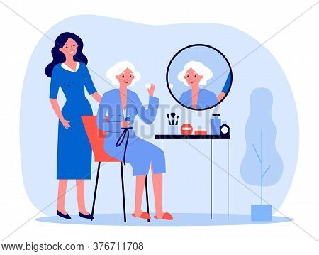 Senior Woman Taking Care About Facial Skin. Lady Sitting At Mirror, Daughter Or Cosmetologist Standi