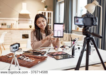 Beauty Blogger Woman Filming, Advertising App On Camera Holding Tablet Pc. Makeup Influencer Asian G