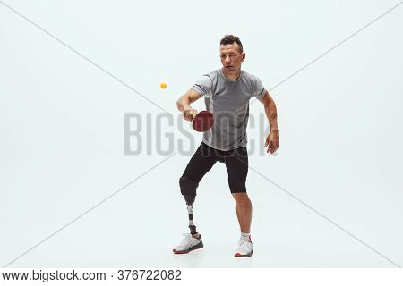 Athlete With Disabilities Or Amputee Isolated On White Studio Background. Professional Male Table Te