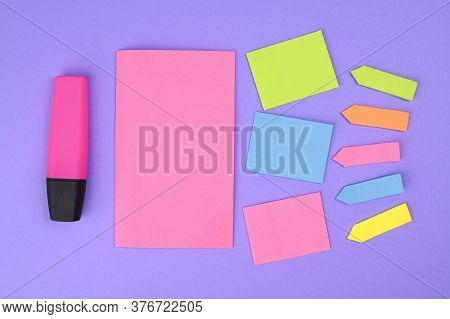Office Stickers. Mock-up Lot Of Yellow Empty Office Stickers On A Purple Background. The Concept Of