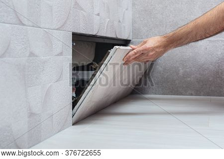Man Opens Hidden Revision Sanitary Hatch On The Wall Of Bathroom