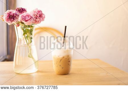 Tasty Drinking, Cup Of Ice Cappuccino Coffee Decorated With White Milk Froth In A Tall Plastic Glass