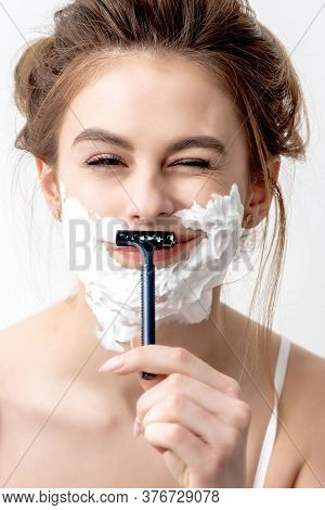 Beautiful Young Caucasian Woman Shaving Her Face By Razor On White Background. Pretty Woman With Sha
