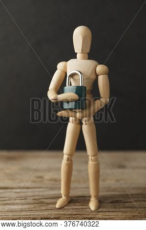 Toy Man Holds Lock In His Hands As A Symbol Of Individual Privacy, A Secret. Intellectual Property P