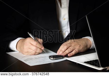 Sales Agent During The Signing Of The Contract Of Sale Or Lease Of A Car. Concept Car Sale, Car Rent