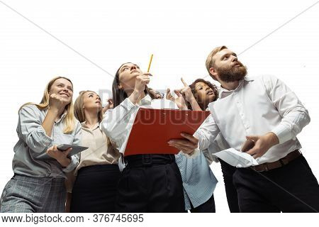 Stress. Nervous Tensioned Investors Analyzing Crisis Stock Market With Charts On Their Gadgets. Defa