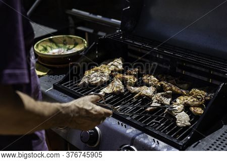 Masculine Hand Preparing Chicken Meat On Barbeque With Copy Space