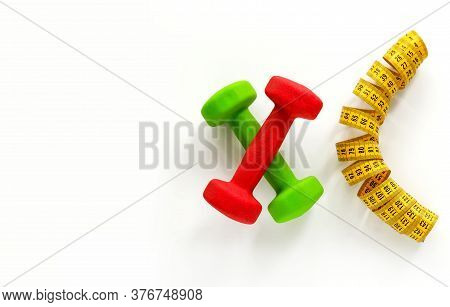 Collage Consists Of Dumbbells And A Centimeter. White Background. There Is A Place For Text. Fitness