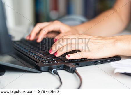 Woman working on laptop from home. Busy people lifestyle. Woman typing on laptop computer. Work from home lifestyle. Urban lifestyle. Woman typing message on laptop computer. Technology lifestyle. Typing message on computer. Laptop computer. Working at ho
