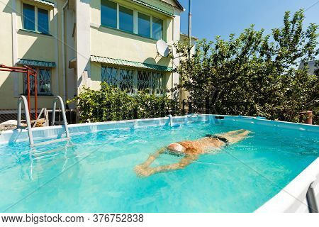 Close Up Of Pensioner Man In The Pool Doing Exercise Alone Swimming - Active People And Healthy And