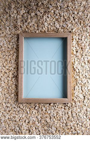 Background With Natural Dry Rolled Oats And With Square Copy Space In Wooden Picture Frame And With