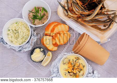 Fried Smelt On A Picnic , Closeup. Small Fish, Lemon, Sea Kale, Croutons, Rice, Mincemeat And Mussel