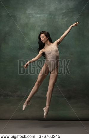 Growth. Graceful Classic Ballerina Dancing On Dark Studio Background. Pastel Bodysuit. The Grace, Ar