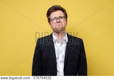 Young Caucasian Business Man Frowning Face In Displeasure