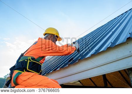 Professional Technical Workers Working Install New Roof,roofing Tools,electric Drill Used On New Roo