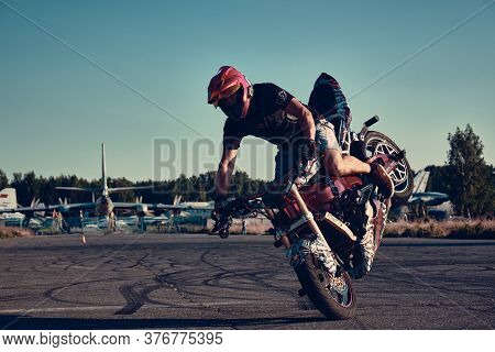 Moscow, Russia - 12 Jul 2020: Moto Rider Making A Stunt On His Motorbike. Motorcyclist Making Wheeli