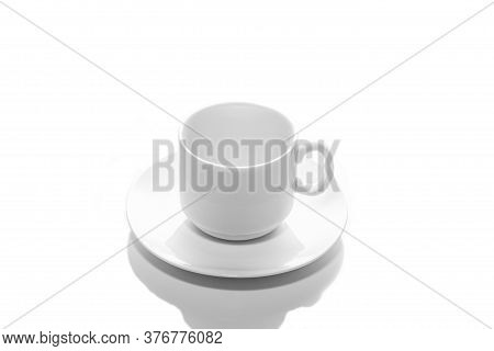 Empty Small White Porcelain Coffee Cup On A White Saucer Top View Isolated On A White Background
